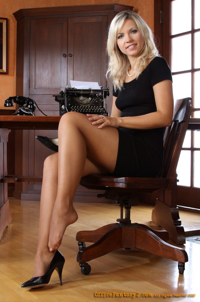 Nude girl in office chair
