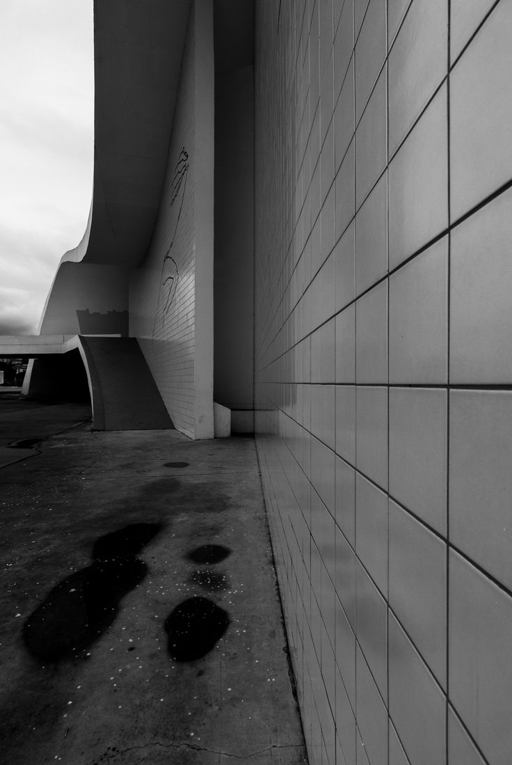 Curves of the time  Nieteroi, Brasil 07-2013   This set of black and white pictures has the aim of drawing the attention of the viewers on the shapes of this construction and on the relationship between lights and shadows, rather than Niemeyer's buildings in themself.   Copyright © Yuri Segalerba, All Rights Reserved