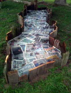 Reclaimed wood garden bed lined with newspapers fluid - Cheap flower bed ideas ...