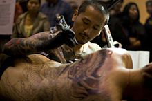 Irezumi - Tattoo artist working on a body suit