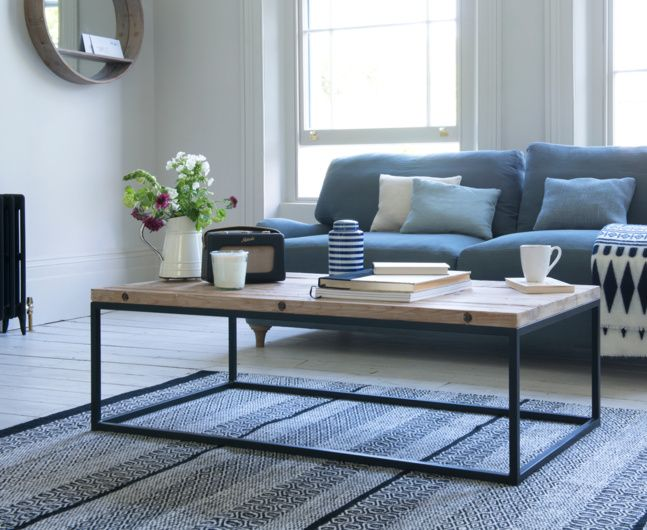 Our Poste coffee table is hand finished giving it a lovely rustic charm. Finished off nicely with a vintage style metal frame.
