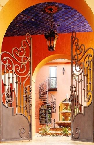 Custom Courtyard Gates & Spiral Stairs mediterranean exterior