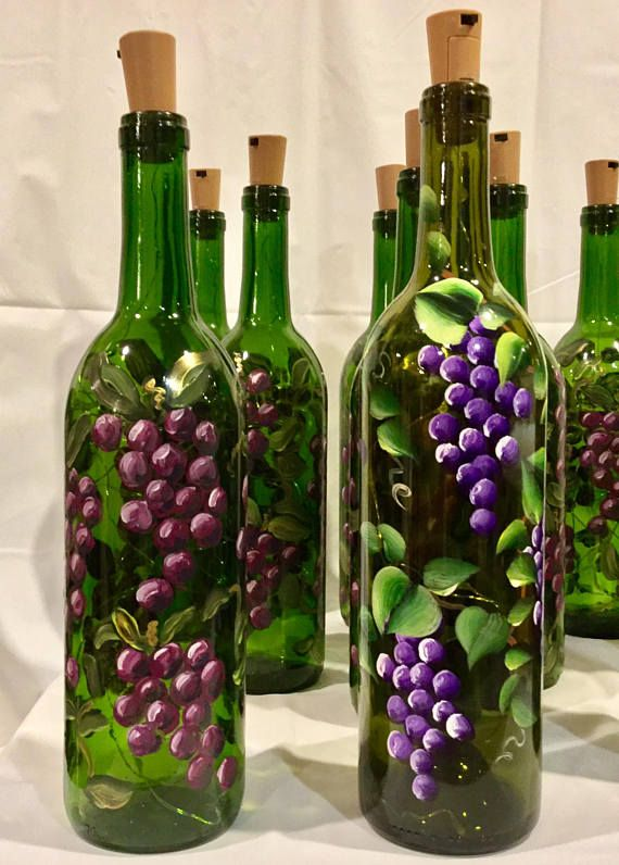 **Made to Order** Brighten your home with this wine bottle light, hand painted with beautiful grape vines and illuminated with with battery powered cork lights. This design can be done with red or purple grapes, your choice. The bottle is painted with enamel paint and oven cured
