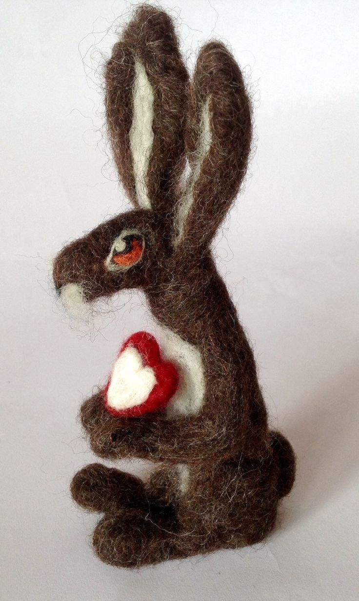 A personal favourite from my Etsy shop https://www.etsy.com/listing/230442834/needle-felted-heart-felt-hare-made-to