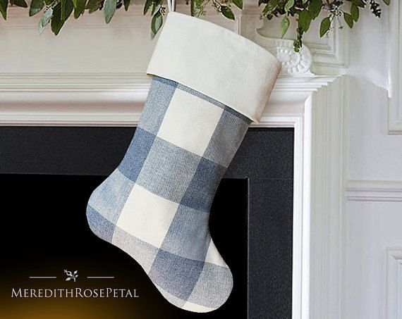 Give your home a charming addition this Christmas. 100% cotton decorator fabric features a bold scale buffalo check in hues of denim blue and natural. Traditionally styled with a relaxed appeal - its an instant classic!  Buffalo check fabric is presented on both sides of the stocking, allowing it to be displayed to the left or right. Exceptionally crafted and fully lined with natural premium cotton, capable of holding lots of goodies at Christmastime. Topped with a natural 100% cotton velvet…