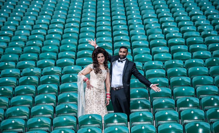 The wedding couple in the Twickenham Stadium Stands for photographs following their wedding in the Rose Suite