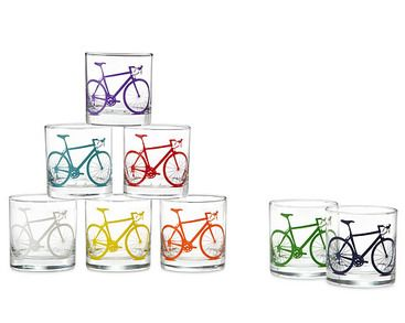 Take all-occasion glassware on a tour de style with these statement-making glasses. Bold bicycle silhouettes are screen printed directly onto these cups using a special ink that cross bonds with the surface, making them dishwasher safe and durable enough to be a part of your daily cycle. Comes in a set of 8 bold colors: green, navy blue, orange, white, turquoise, yellow, red and purple. Glasses made in Louisiana. Printed in Denver, Colorado.
