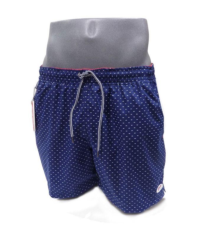 f98d47782 Mira los nuevos estampados para bañadores de hombre con prints de motivos  playeros  fondo en azul marino con prints de pececillos en blanco.