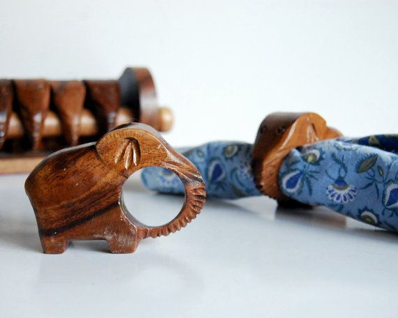 Fun set of vintage wood napkin rings in the shape of elephants, made in the 1970s or so, in the Philippines. Description from etsy.com. I searched for this on bing.com/images