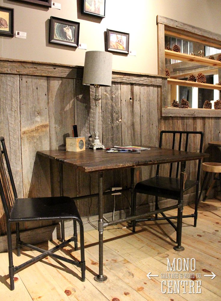 """We have given these solid oak farm fence boards a second life as part of our """"Greener Pastures"""" line. Industrial steel pipe legs meet rustic reclaimed boards to create a unique table for two. Perfect for a local coffee shop, a modern condo or even outdoors. Stop by Higher Ground Coffee Co. to check it out! #monocentresalvage #reclaimed #rustic #salvage #barnboard"""