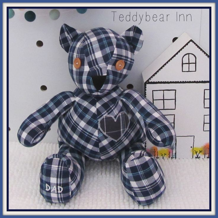 Memory teddybear made from the shirt of a loved father. Featuring appliqued heart and wooden eyes on this teddy.