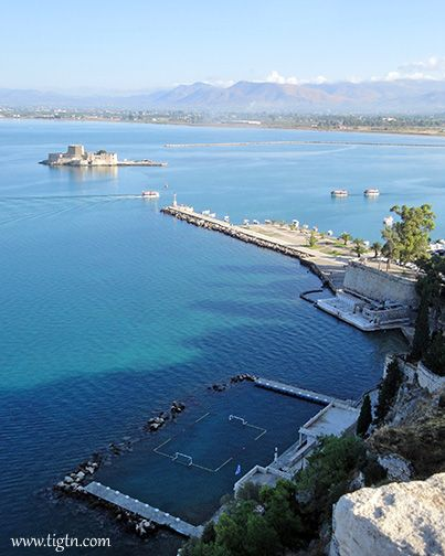 Looking down to #Bourtzi Fortress, the Nafplio Yacht Club and the start of #Arvanitia Promenade from the walls of #Akronafplia Castle in the #Peloponnese - #Greece
