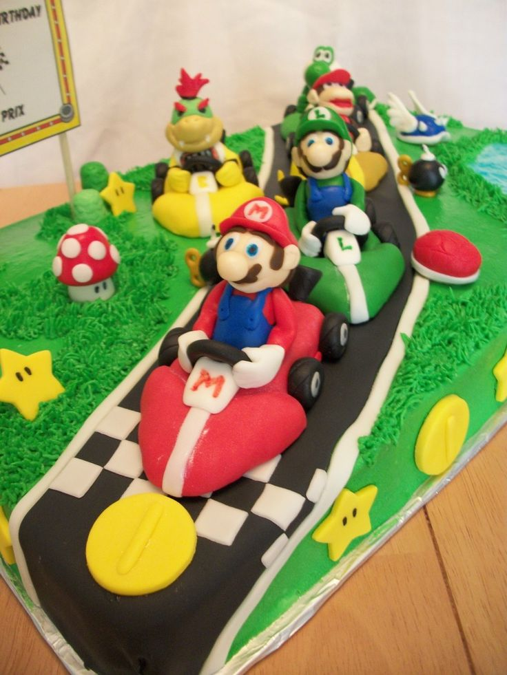 Mario Kart Birthday Cake This is a 1/2 vanilla sheet cake for a boy turning seven. Mario Kart characters included are Mario, Luigi, Diddy...