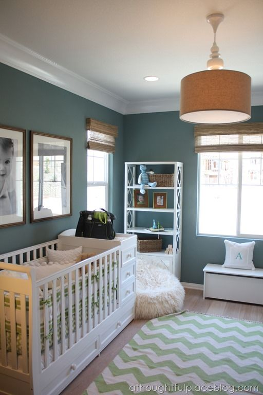 Baby/kids space ideas: Love the rug, light fixture, big B&W photos, and fuzzy floor pillow!