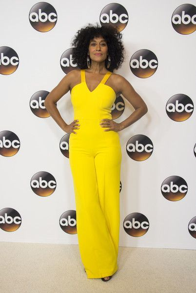 d1c56b540670 Tracee Ellis Ross Jumpsuit - Tracee Ellis Ross easily stood out in this  canary-yellow halter jumpsuit by SAFiYAA at the Disney ABC Summer TCA Tour.