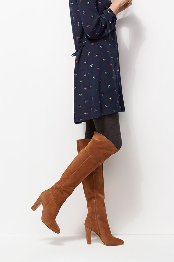 When the weather dips, layer up in opaque tights and soft-cut suede. Aldo's tobacco tone knee-high boots are a versatile footwear choice; partner with a shirt dress or wide-leg trousers for casual elegance.    Vanessa Bruno dress Aldo boots