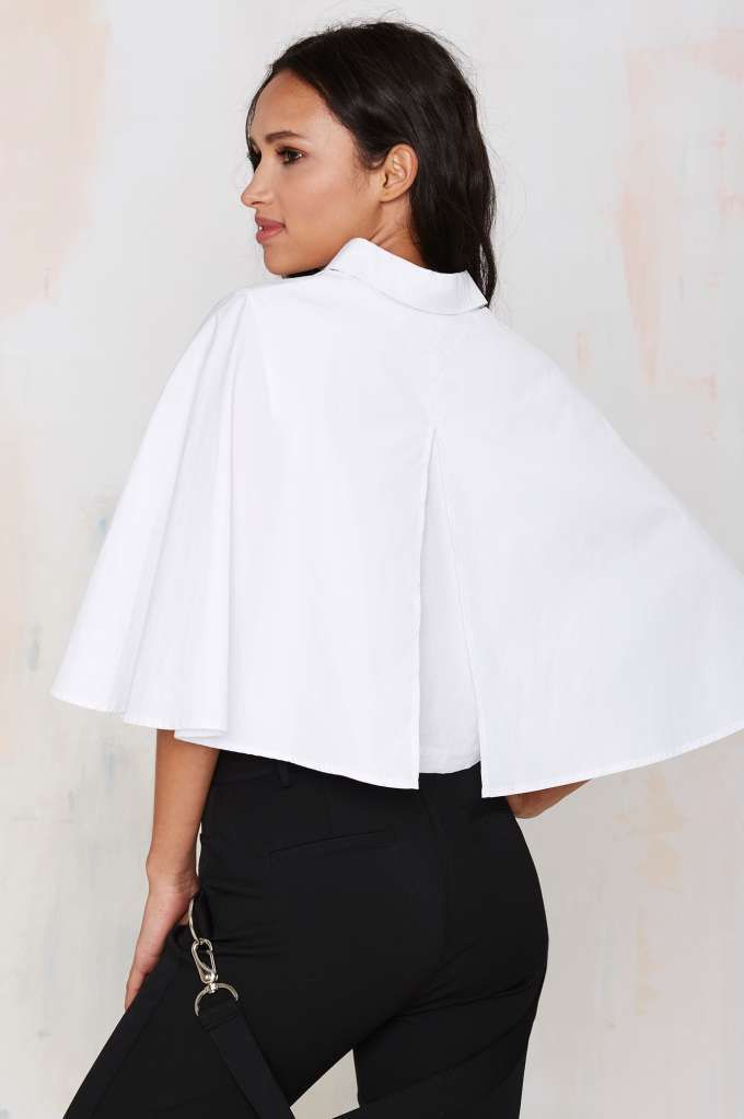 Get ready to fly high in this white crop caplet blouse.