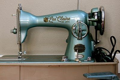 pretty blue vintage sewing machine - class 15 type with tension on the back side -- straight stitch