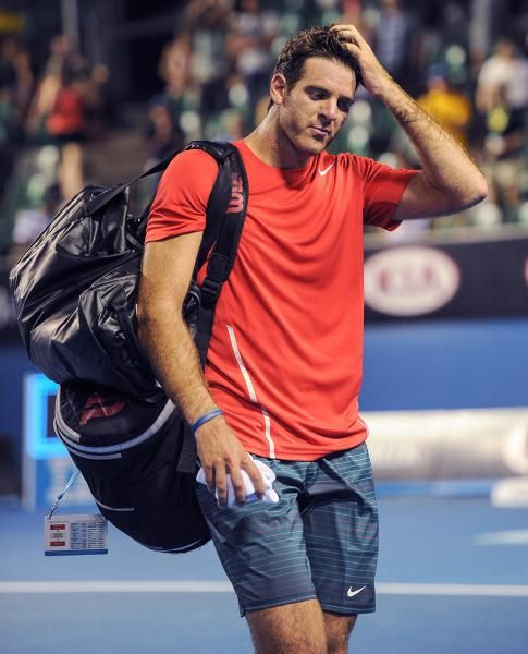 Juan Martin del Potro of Argentina walks from the court after losing to Roberto Bautista Agut of Spain in their second round match. (Andrew Brownbill/AP)