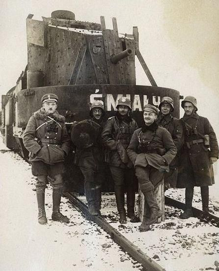 """Artillery wagon of the armored train """"Śmiały"""". On the left side Lt. Stanislaw Małagowski (who died on July 25, 1919.). On the right side (in the cap) Lt.. Stanislaw Biega."""