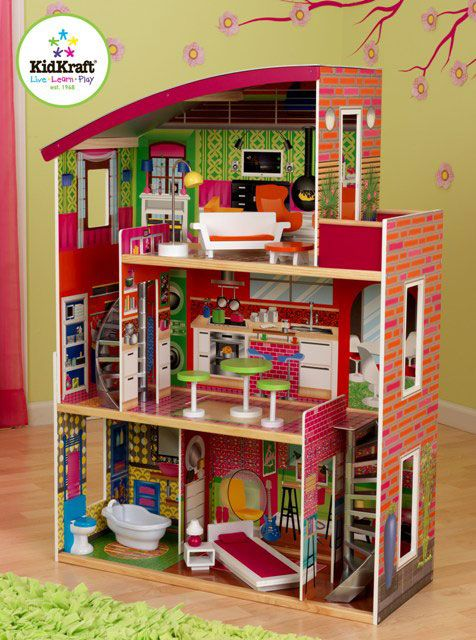 Designer Dollhouse by Kidkraft Now this is what a dream house looks like! Designer Dollhouse is full of stylish details like a two spiral staircases and hip artwork in every room of the house. Young girls are sure to love moving the furniture pieces around from room to room of this precious dollhouse and being their very own interior designer.