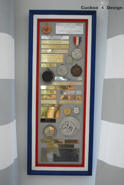 repurposing old medals and plaques in a collage. use the engraved portion without keeping the trophy or plaque