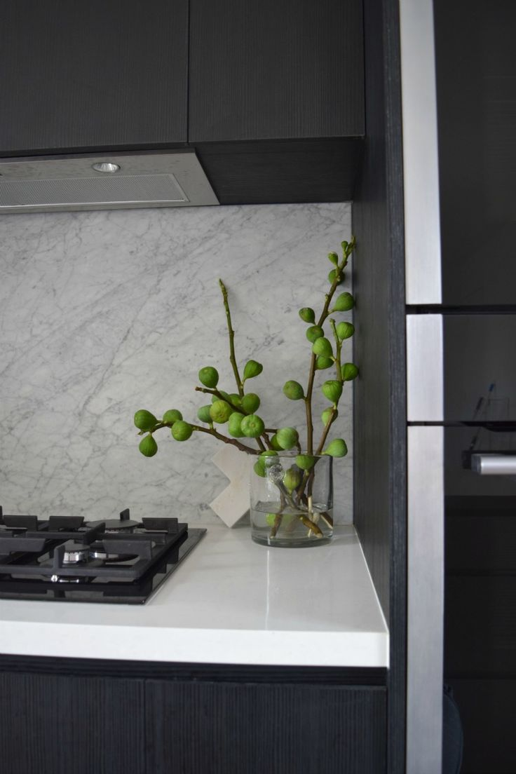 Love fig branches as an alternative to flowers! Here's a peek at Gina's black and white kitchen with marble splashback. Check out loads more photos and read about her design decisions on the blog >>