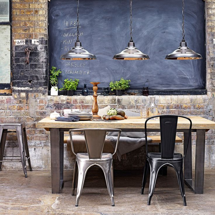 quite lovely! the brick, the chalkboard, the greens and the metal pendants make for a beautiful play of elements and textures