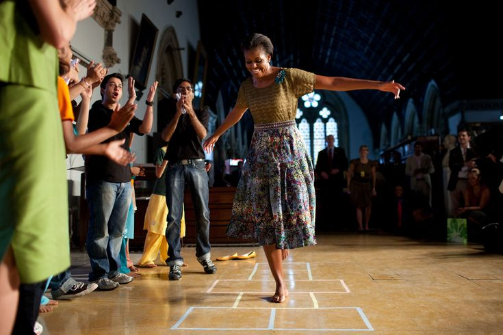 "https://flic.kr/p/8Zwcgc | P110610CK-0355 | First Lady Michelle Obama plays hopscotch during the ""Make A Difference""  program  at the University of Mumbai in Mumbai, India, Nov. 6, 2010.  (Official White House Photo by Chuck Kennedy)  This official White House photograph is being made available only for publication by news organizations and/or for personal use printing by the subject(s) of the photograph. The photograph may not be manipulated in any way and may not be used in commercial or…"