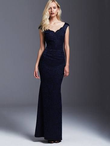 This gown is flattering and definitely a one of a kind gown this season. Made from a midnight blue lace bonded on a black knit base with contrasting shoulders and the dress back in a midnight blue silk satin. This gown fits impeccably to the body. Hugging the body in the right places creating an amazingly elegant silhouette. MOSS & SPY AW 2016 Collection. ASPIRATIONS.38 Church Street, Brighton. Tel 95932007