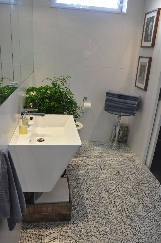 Mina's finished bathroom! Using the Batik Series on the floor and White Gloss 300x600mm on the wall. How stunning does this look?