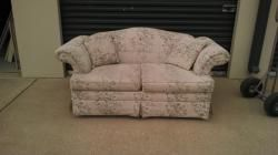 """VERY NICE LOVE SEAT TAN WITH FLORAL PATTERN 68""""X28""""X31""""  THIS ITEM WAS DONATED TO THE TEMPLE COMMUNITY CLINIC AND PROCEEDS FROM THE AUCTION OF THIS ITEM WILL GO TO THE TEMPLE COMMUNITY CLINIC FOR OPERATIONS AND EQUIPMENT.  THIS ITEM WAS DONATED BY FORREST AND SANDEE MIDDLETON"""