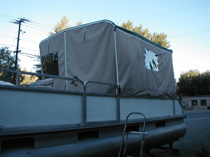 Side covers with zippers and windows for a pontoon boat