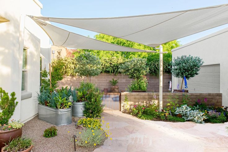 How To Build A Concrete Wall For Your Own Private Backyard Retreat Concrete Blocks Concrete Retaining Walls Garden Shade Sail