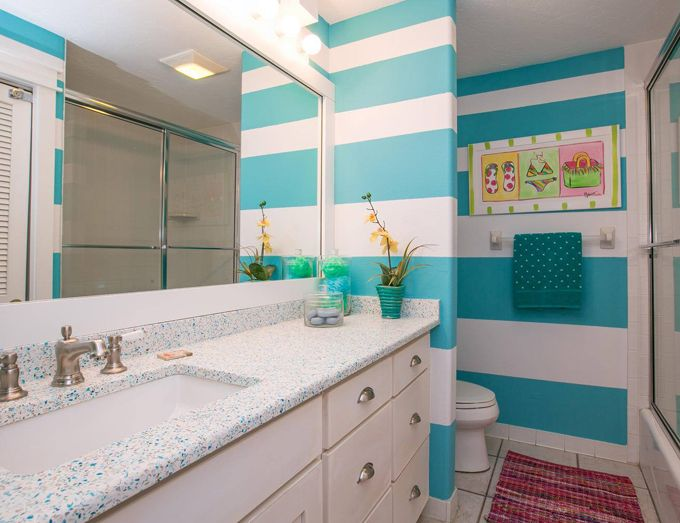 turquoise striped beach house bathroom