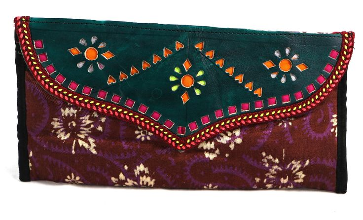 Leather and accented Printed Fabric. It has functional double compartments: a Bi-Fold compartment with plenty credit card slots and currency sections, and a flap compartment with more credit card slots, an open compartment for checkbook, and a zipped pocket. #Buyhandbagsonline #HandmadeHandbags #Authenticdesignerhandbags #Womenswallets #Pursesonline #Handmadeitems #Styleincraft