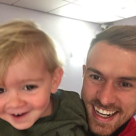Aaron Ramsey with his son