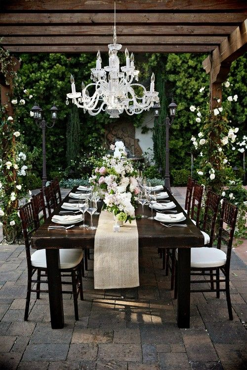Outdoor dining, love the chandelier.