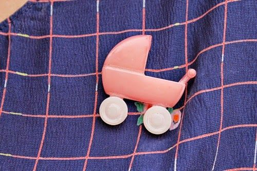 Brittany topped of her vintage outfit with the broesj' pink vintage plastic baby carriage brooch