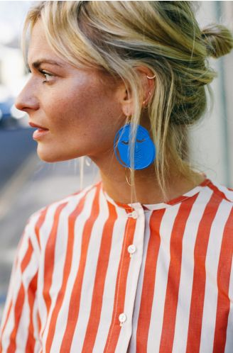 Shop now. Pandora Sykes wears our Exclusive JW Anderson Moonface Earrings.