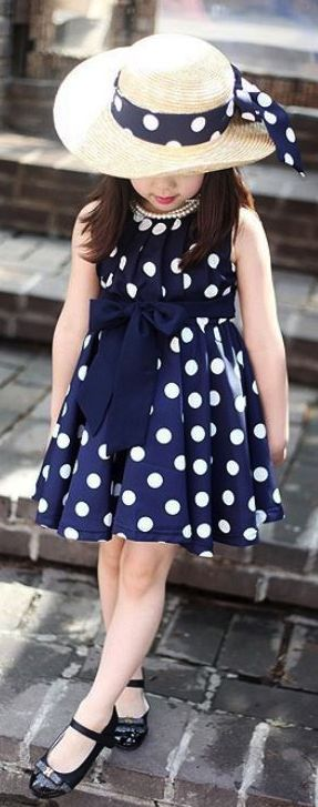Adorable little girl in a vintage style polka dot dress and hat!