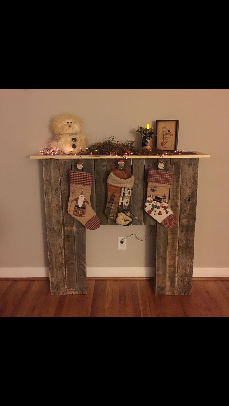 Faux fireplace made from wood pallets. Finally a place to hang our stockings! Thanks hubby!