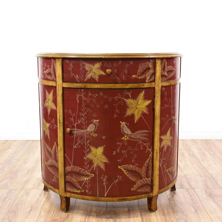 This cabinet is featured in a solid wood with a glossy burgundy finish. This contemporary style console has gold floral accents, interior shelving, and a single spacious drawer. Perfect for storing sewing supplies! #contemporary #storage #cabinet #sandiegovintage #vintagefurniture