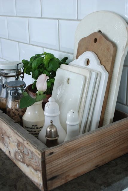 13 Ways To Hack Your Hideous Rental Kitchen On A Budget (Without Losing Your Deposit) #1 Instead of counter clutter, stack your stuff in a vintage box.