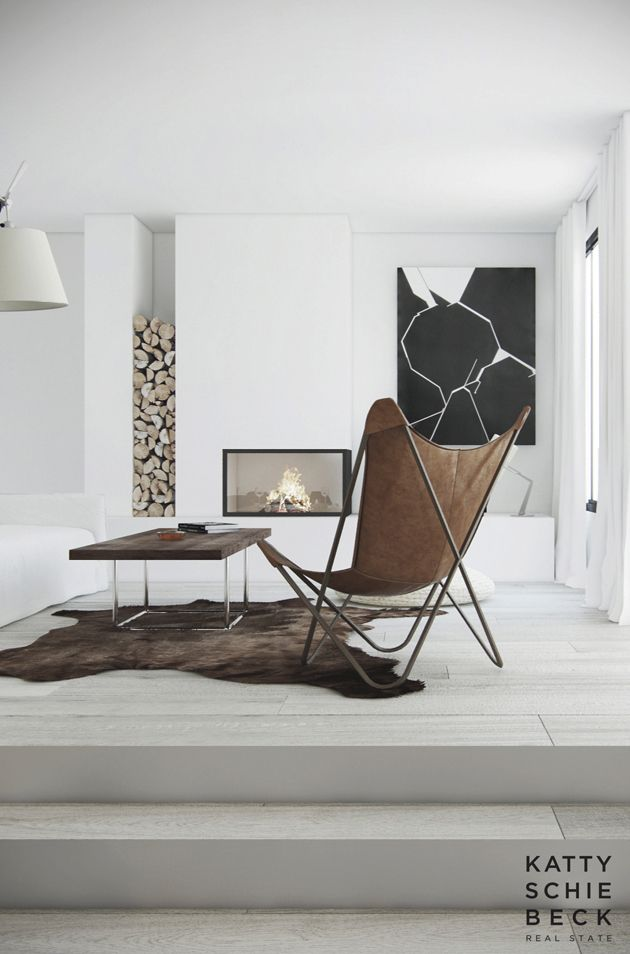 Minimalist interior white walls - cool way to store firewood