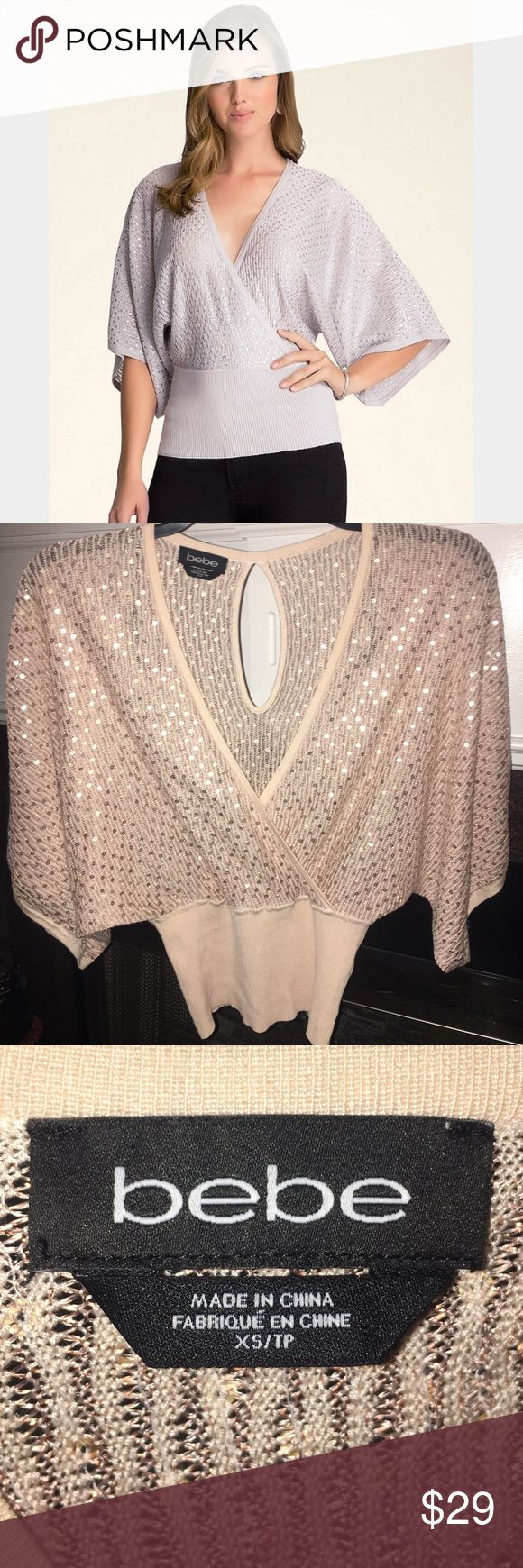 BEBE Gold Sequin Kimono Batwing Sweater Top XS S Super jazzy BEBE Sweater top! It is a nude tan/light brown color with gold sequins and metallic weave. Dramatic v-neck in the front and keyhole opening in the back. Ribbed trim hugs the curves and makes you look amazing!!! 1st pic is stock photo-making it look more silver. Other pics are mine of actual top. It's a size XS but can fit a S Small as well. bebe Sweaters V-Necks