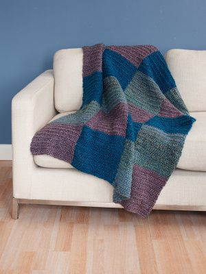 Square Deal Throw: Feel calm and peaceful with the water-like shades of Homespun® used to make this crocheted throw. | #afghan #blanket #pattern