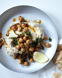 Hummus with Tahini  ~ Michael Solomonov makes his signature hummus with an unusually generous amount of tahini—something that distinguishes the hummus of his native Israel from that of other Middle Eastern countries. He tops the dish with warm chickpeas fried with jalapeño, cumin and crushed Aleppo pepper.