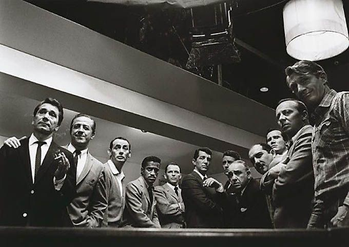 """Photograph by Sid Avery - The original cast of """"Ocean's 11″ (1960) – from left to right: Nick Conti, Jerry Lester, Joey Bishop, Sammy Davis Jr., Frank Sinatra, Dean Martin, Peter Lawford, Akim Tameroff, Richard Benedict, Henry Silva, Norman Fell and Clem Harvey"""