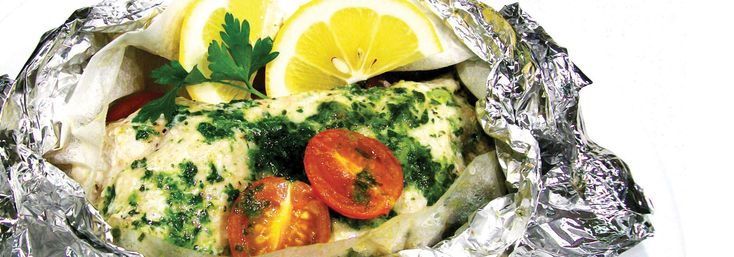Baked parcel of Hapuku (or monkfish) fillet, cherry tomatoes, potatoes and parsley